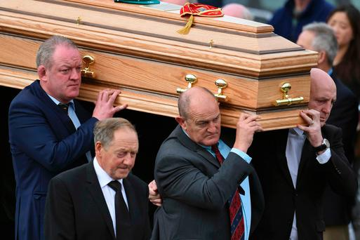 The coffin of Munster rugby coach Anthony Foley is carried from St. Flannan's Church after his funeral service in Killaloe Photo: Reuters