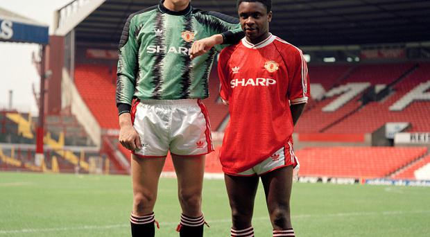 Manchester United footballers Peter Schmeichel (left) and Paul Parker at Old Trafford in Manchester, circa August 1991. (Photo by Harry Goodwin/Paul Popper/Popperfoto/Getty Images)
