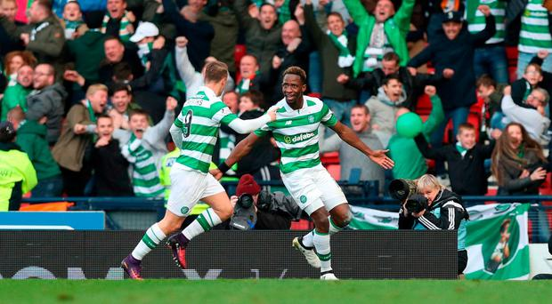 Moussa Dembele celebrates scoring the winner