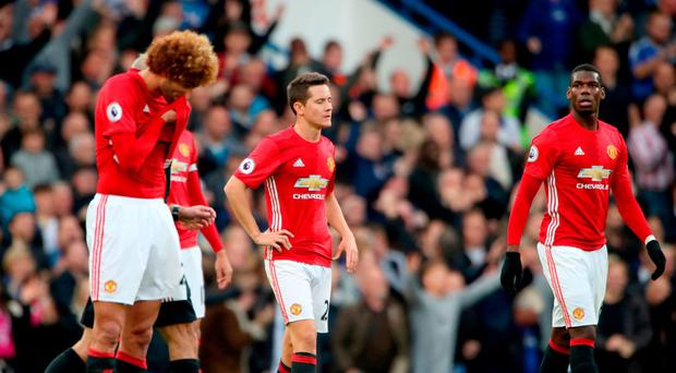 Manchester United's Marouane Fellaini, Ander Herrera and Paul Pogba dejected after Chelsea scored their second goal