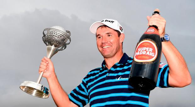 Padraig Harrington poses with the trophy and a bottle of beer following his victory during day four of the Portugal Masters at Victoria Clube de Golfe in Vilamoura, Portugal. (Photo by Stuart Franklin/Getty Images)