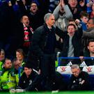Manchester United's Portuguese manager Jose Mourinho (L) starts walking toward the tunnel at the final whistle of the English Premier League football match between Chelsea and Manchester United at Stamford Bridge today
