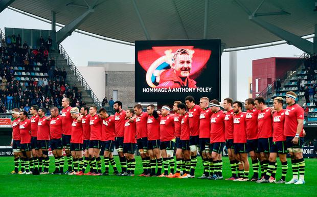 Leinster players stand for a minute's silence in memory of Anthony Foley before their match against Montpellier yesterday. Photo: Stephen McCarthy
