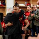 Simon Zebo hugs President Michael D Higgins after the game. Photo: Inpho/Dan Sheridan