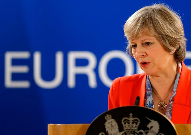 Theresa May could slash corporation tax to 10pc if the EU uses Brexit negotiations to block Uk banks and businesses from the single market. (AP Photo/Alastair Grant)