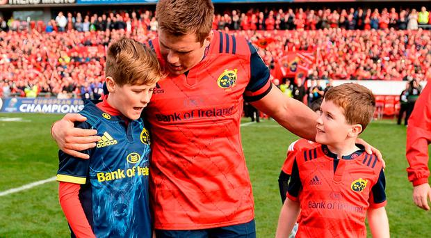 The sons of the late Anthony Foley, Tony (L) and Dan, join CJ Stander and the rest of the squad on the field after Saturday's game SEB DALY/SPORTSFILE