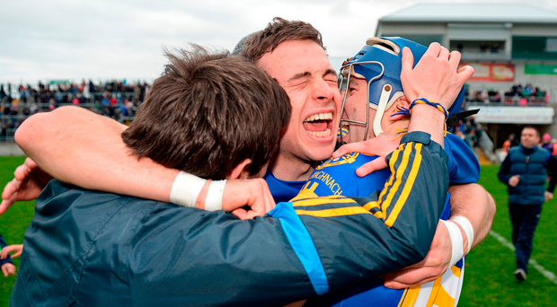 Stephen Quirke (centre) of St Rynagh's celebrates with his brother Paul Quirke (right) at the final whistle in Tullamore Photo: Cody Glenn/Sportsfile