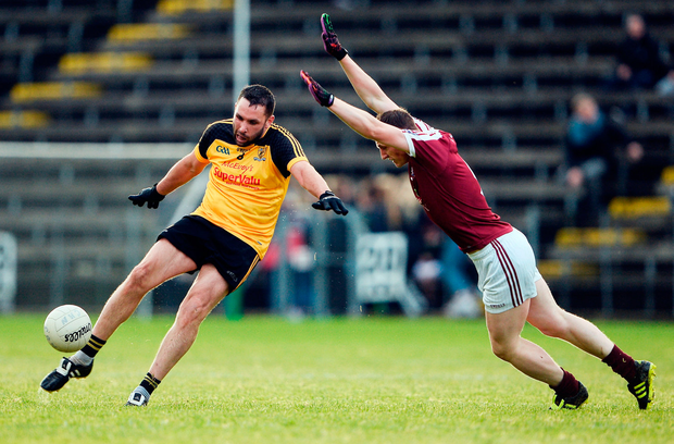 Castlerahan's Fergal Reilly attempts to block a kick from Ramor's Stephen Monaghan Photo: Sam Barnes/Sportsfile