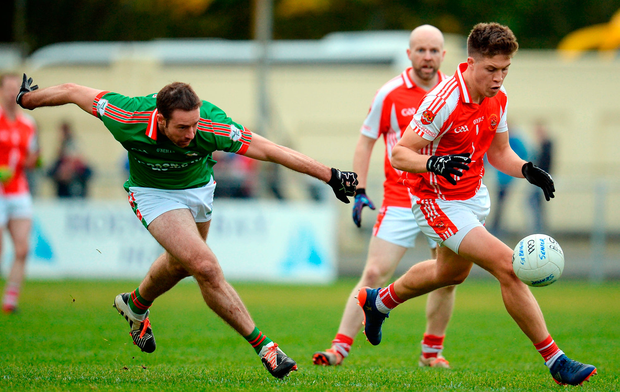 Darragh Donnelly of St Brigid's attempts to catch up to Ronan Daly of Padraig Pearses Photo: Seb Daly/Sportsfile