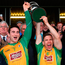 Corofin's Alan Burke (left) and Ciaran McGrath lift the cup following their victory in the Galway County SFC final Photo: Ramsey Cardy/Sportsfile