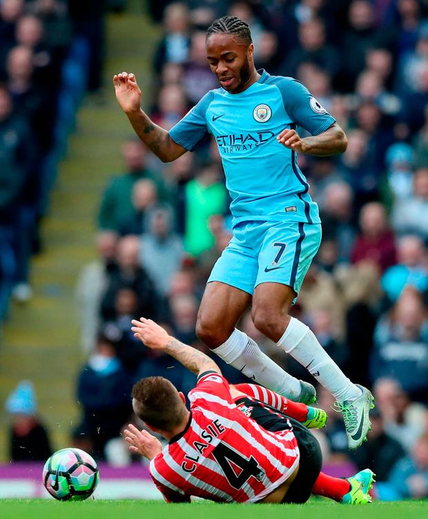 Southampton's Jordy Clasie tackles Manchester City's Raheem Sterling Photo: Martin Rickett/PA Wire