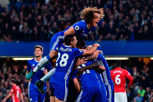Chelsea players celebrate after N'Golo Kante put away their fourth goal Photo: GLYN KIRK / AFP / Getty Images