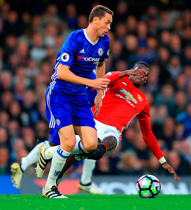 Chelsea's Nemanja Matic (left) and Manchester United's Paul Pogba battle for control of the ball Photo: John Walton/PA Wire