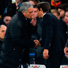 Jose Mourinho makes his feelings known to Antonio Conte Photo: GLYN KIRK/AFP/Getty Images