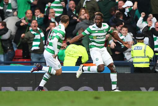 Moussa Dembele celebrates with Leigh Griffiths after he scores through the legs of Matt Gilks (Photo by Ian MacNicol/Getty Images)