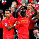 Liverpool's Sadio Mane (right) celebrates scoring his side's first goal of the game Photo: Dave Howarth/PA Wire
