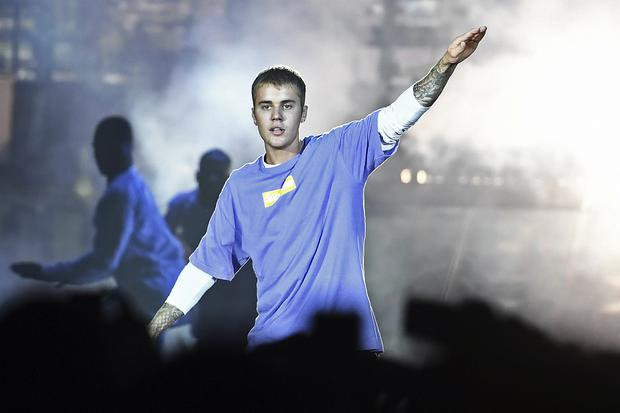 Justin Bieber on stage. Photo: CHRISTOPHE ARCHAMBAULT/AFP/Getty Images