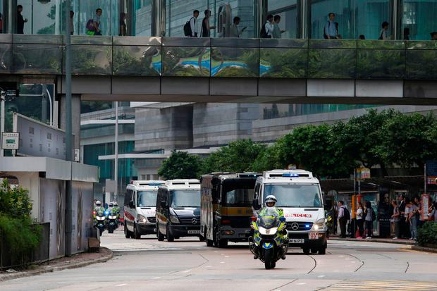 A motorcade taking British former banker Rurik Jutting to High Court in Hong Kong, China October 24, 2016. REUTERS/Bobby Yip