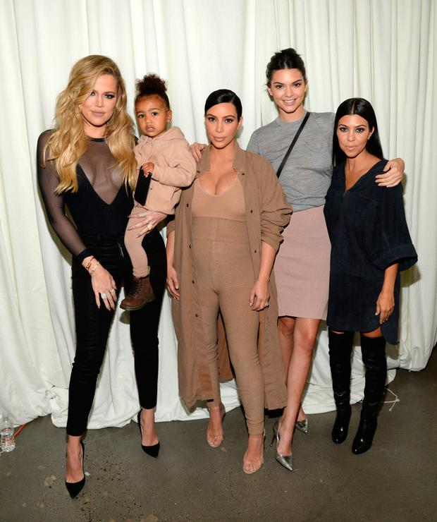 Khloe Kardashian, North West, Kim Kardashian West, Kendall Jenner and Kourtney Kardashian attend Kanye West Yeezy Season 2 during New York Fashion Week at Skylight Modern on September 16, 2015 in New York City. (Photo by Kevin Mazur/Getty Images for Kanye West Yeezy)