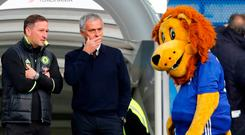 Manchester United manager Jose Mourinho speaks with Chelsea assistant first team coach Steve Holland before the match