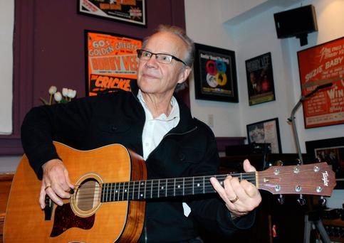 Bobby Vee plays the guitar at his family's Rockhouse Productions in St. Joseph, Minn. (AP Photo/Jeff Baenen, File)