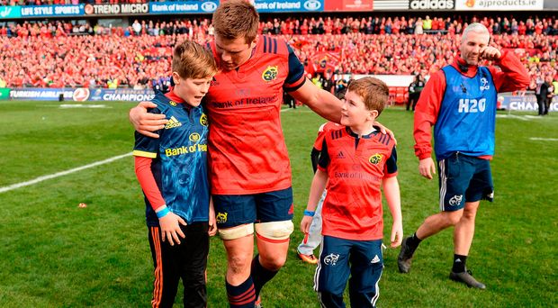 Tony (11) and Dan Foley (8) with CJ Stander after they joined the Munster squad on the pitch at Thomond Park. Photo: Seb Daly