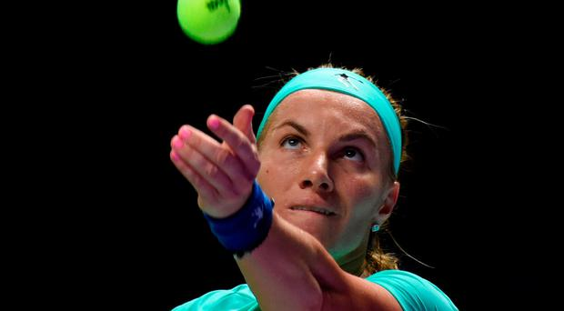 Svetlana Kuznetsova serves against Agnieszka Radwanska of Poland during their women's singles match at the WTA Finals tennis tournament in Singapore