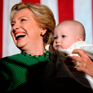 Democratic presidential nominee Hillary Clinton holds a baby during a rally at the University of North Carolina in Charlotte, on Sunday Photo: ROBYN BECK/AFP/Getty Images