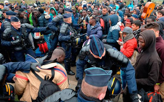 French police step in break up clashes in the 'Jungle' camp Photo: John Stillwell/PA Wire