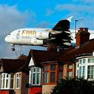 Emirates Airbus A380 plane landing over houses in Myrtle Avenue near Heathrow Airport, as a third Heathrow runway has been given the go-ahead, the Government has confirmed. Photo: Steve Parsons/PA Wire