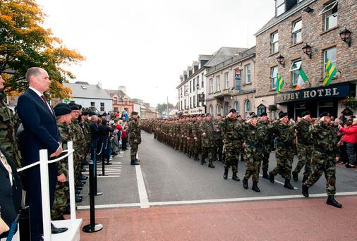 Minister of Defence Paul Kehoe TD inspects the troops of the 109th Infantry Batallion as they march past in The Diamond, Donegal Town, Co. Donegal, ahead of the troops deployment to Lebanon as part of UNIFIL.