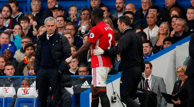 Manchester United manager Jose Mourinho looks at Eric Bailly as he comes off injured