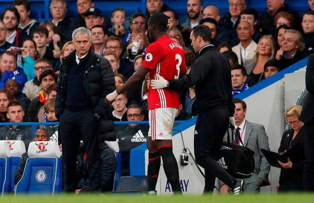 Manchester United manager Jose Mourinho looks at Eric Bailly as he goes off injured