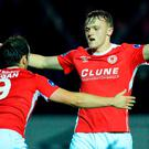 Jonathan Lunney, right, of St Patrick's Athletic is congratulated by teammate Christy Fagan, left, after scoring his side's fifth goal during the SSE Airtricity League Premier Division match between St Patrick's Athletic and Dundalk at Richmond Park. Photo by Seb Daly/Sportsfile
