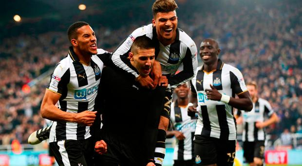Aleksandar Mitrovic of Newcastle United (C) celebrates scoring his sides fourth goal with his team mates