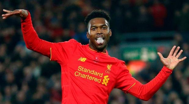 Liverpool's Daniel Sturridge celebrates scoring the second goal of the game during the English League Cup soccer match between Liverpool and Tottenham Hotspur at Anfield