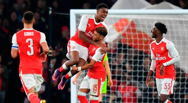 Arsenal's Alex Oxlade-Chamberlain celebrates his first goal with Alex Iwobi. (Photo by Michael Regan/Getty Images)