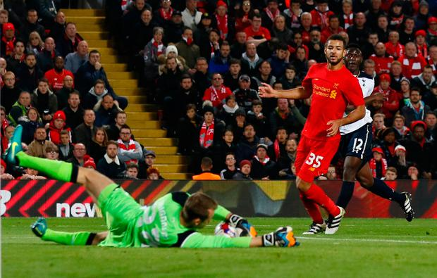 Liverpool's Simon Mignolet gathers up a shot from Victor Wanyama . REUTERS