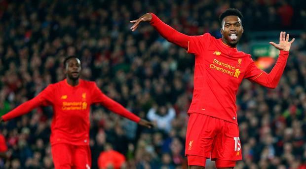 Liverpool's Daniel Sturridge celebrates scoring the second goal of the game during the English League Cup soccer match between Liverpool and Tottenham Hotspur at Anfield. (AP Photo/Dave Thompson)