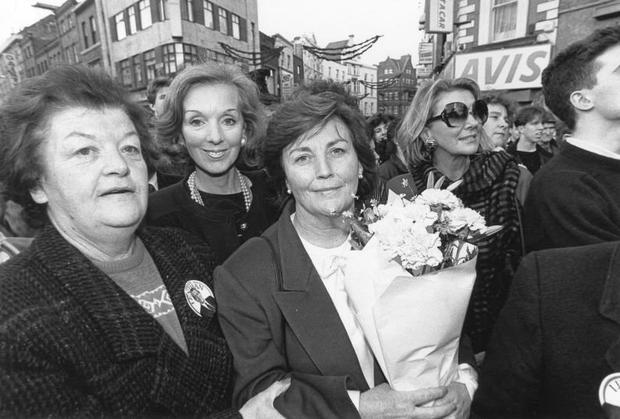 Ann Lenihan holding flowers while canvassing for her husband during the presidential campaign in 1990 Picture: John Carlos
