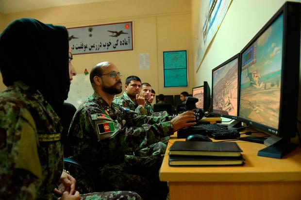 In this photograph taken on September 29, 2016, new Afghan air force pilots attend a class with flight simulators at the air force university in Kabul./ AFP PHOTO / SHAH MARAISHAH MARAI/AFP/Getty Images