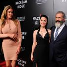 Caitlyn Jenner, actor Mel Gibson and Rosalind Ross arrive at the screening of Summit Entertainment's