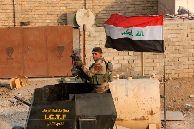 A member of Iraq's elite counterterrorism forces holds his weapon as forces advance toward Islamic State positions in the village of Tob Zawa, about 9 kilometers (5½ miles) from Mosul, Iraq, Tuesday, Oct. 25, 2016. (AP Photo/Khalid Mohammed)