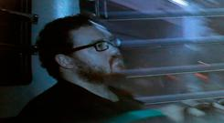 Rurik Jutting, a British banker, sitting in a prison bus arrives at a court in Hong Kong. (AP Photo/Vincent Yu, File)