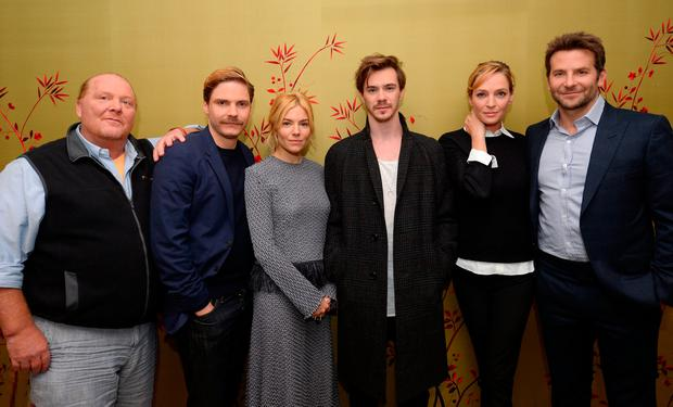 Sam Keeley (centre) with fellow Burnt cast members, from left: Daniel Bruhl, Sienna Miller, Uma Thurman and Bradley Cooper