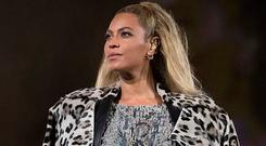 Beyoncé in custom-made Tom Ford crystal embroidered snakeskin print body suit and boots with a leopard print coat