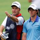Rory McIlroy with his caddie, JP Fitzgerald. REUTERS/Jason Reed