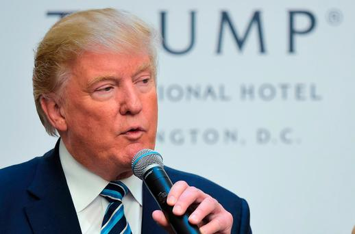 Republican presidential nominee Donald Trump speaks during a ribbon cutting ceremony at the grand opening of the Trump International Hotel in Washington DC. GETTY