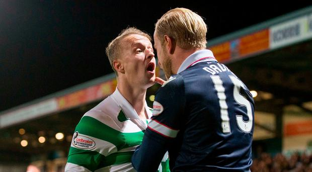 Ross County's Andrew Davies (right) and Celtic's Leigh Griffiths (left) exchange words during the Ladbrokes Scottish Premiership match at the Global Energy Stadium