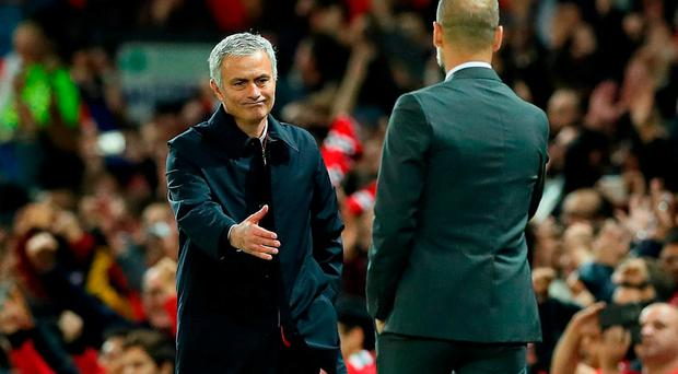 Manchester United manager Jose Mourinho (left) and Manchester City manager Pep Guardiola shake hands after the EFL Cup, round of 16 match at Old Trafford